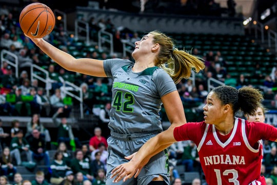 Michigan State's Kayla Belles, left, grabs a rebound in front of Indiana's Jaelynn Penn during the second quarter on Monday, Feb. 11, 2019, at the Breslin Center in East Lansing.