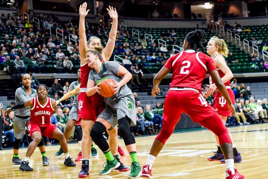 Michigan State's Jenna Allen, center, moves to the basket as Indiana's Linsey Marchese defends during the fourth quarter on Monday, Feb. 11, 2019, at the Breslin Center in East Lansing.