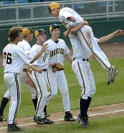 Drew Huard, seen here in 2006, leaped into the arms of Grand Ledge High School teammate Tom Howard at the end of their team's come-from-behind victory over Homer. It occurred in the Capital Diamond Classic's championship game at Cooley Law School Stadium in Lansing.
