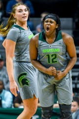 Michigan State's Nia Hollie, right, celebrates after making a basket as teammate Kayla Belles, left, looks on during the second quarter on Monday, Feb. 11, 2019, at the Breslin Center in East Lansing.