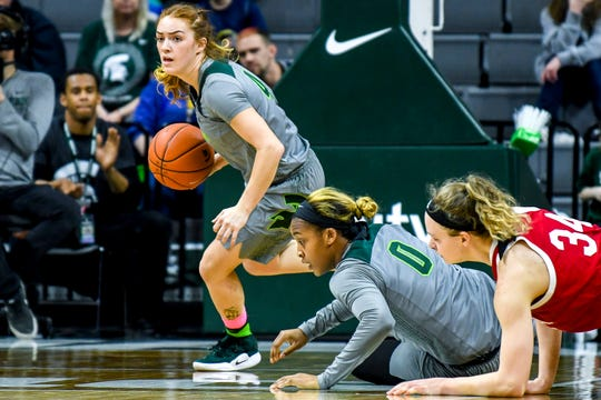 Michigan State's Taryn McCutcheon, left, breaks with the ball after teammate Shay Colley, center, grabbed a ball from Indiana's Grace Berger, right, during the second quarter on Monday, Feb. 11, 2019, at the Breslin Center in East Lansing.