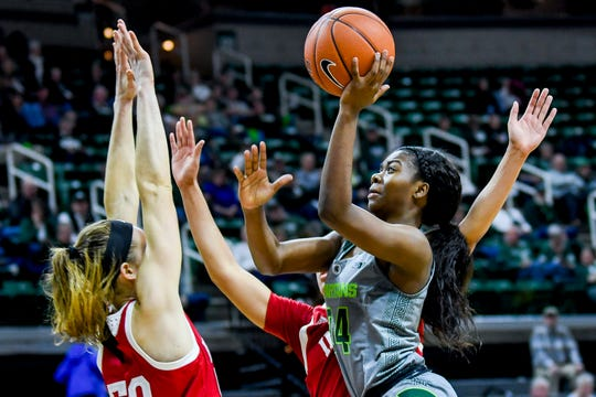 Michigan State's Nia Clouden scores during the fourth quarter on Monday, Feb. 11, 2019, at the Breslin Center in East Lansing.