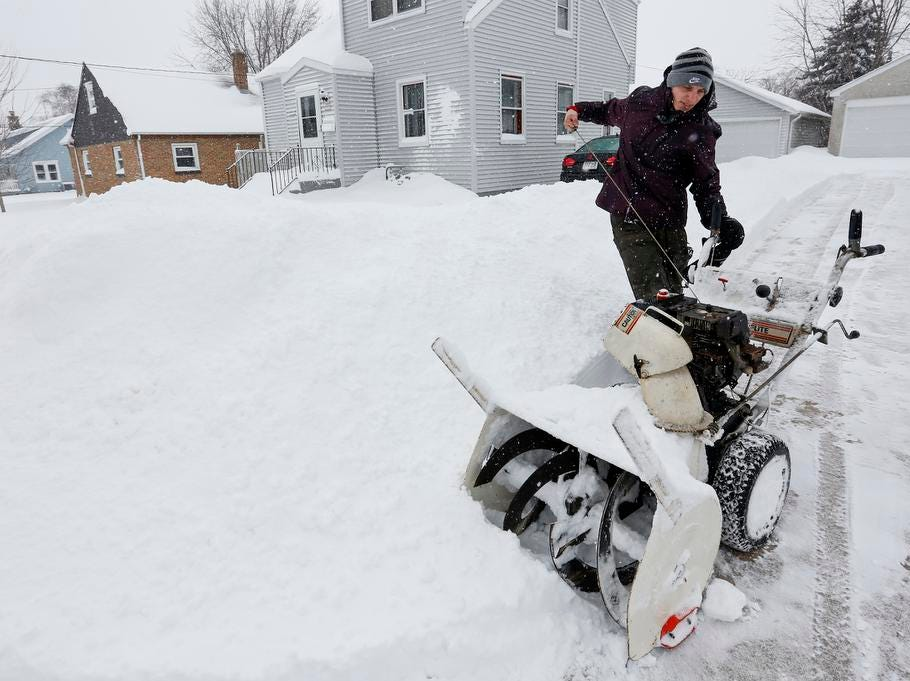 Charlie Zurek, of Manitowoc, starts his snowblower to clear his neighbor's driveway  as snow blankets the area Tuesday, February 12, 2019, in Manitowoc, Wis. The latest winter storm to hit Wisconsin is expected to bring 6-12 inches by the end of Tuesday.