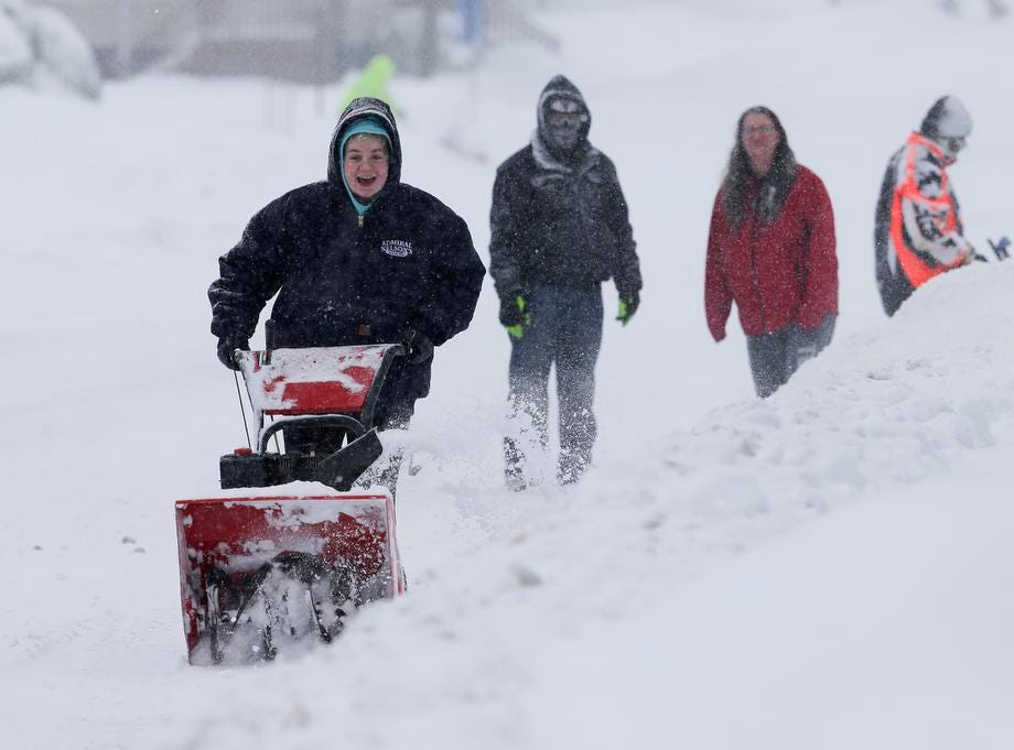 Brianna Brachmann clears the sidewalk as her parents Brian and Tracy watch her learn to use the snowblower Tuesday, February 12, 2019, in Manitowoc, Wis. The latest winter storm to hit Wisconsin is expected to bring 6-12 inches by the end of Tuesday. Joshua Clark/USA TODAY NETWORK-Wisconsin