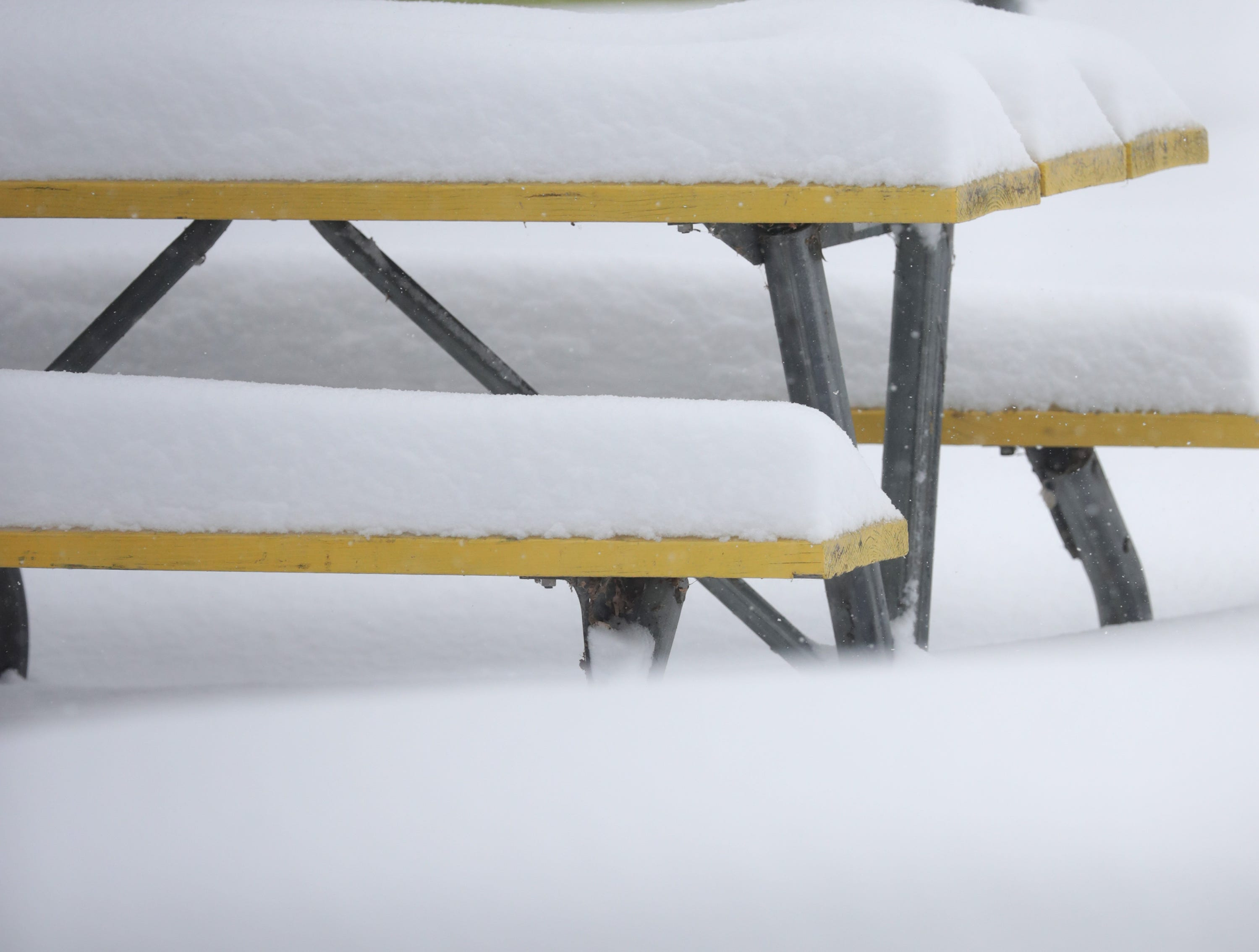 Picnic tables buried in snow on Tuesday, February 12, 2019, at the 1000 Islands Environmental Center in Kaukauna, Wis. The latest snow storm to move through the state dropped several inches of snow overnight, 6 to 12 inches are expected by Tuesday evening.