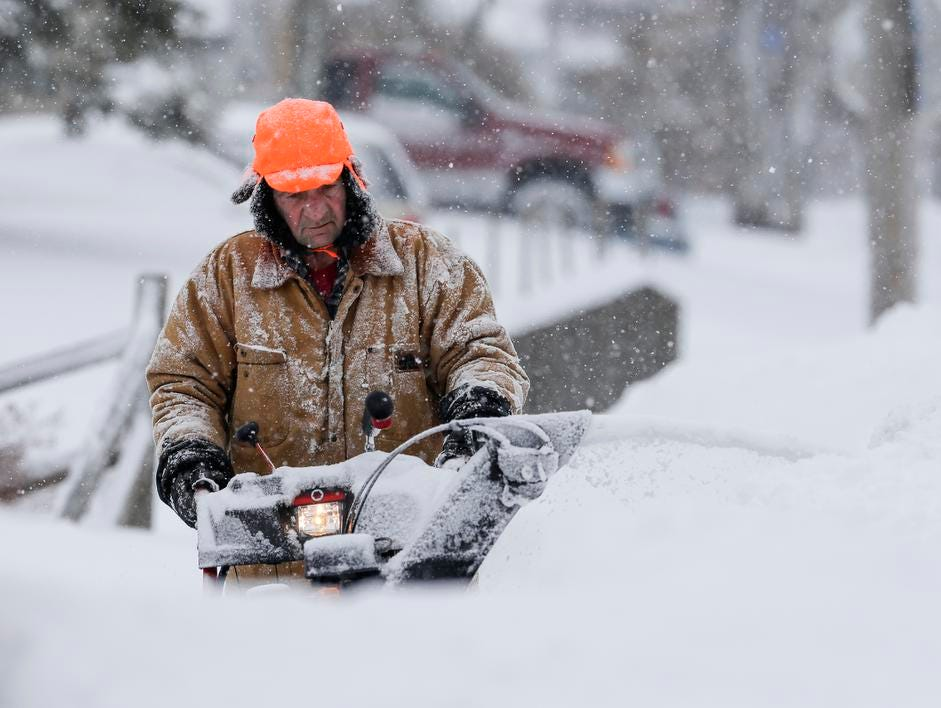 David Gauthier Sr., of Manitowoc, clears his sidewalk with a snowblower Tuesday, February 12, 2019, in Manitowoc, Wis. The latest winter storm to hit Wisconsin is expected to bring 6-12 inches by the end of Tuesday. Joshua Clark/USA TODAY NETWORK-Wisconsin