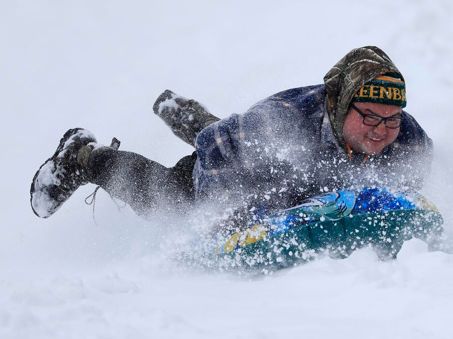 Jonas Hill sleds at Fireman's Park on Tuesday, February 12, 2019 in Green Bay, Wis.
