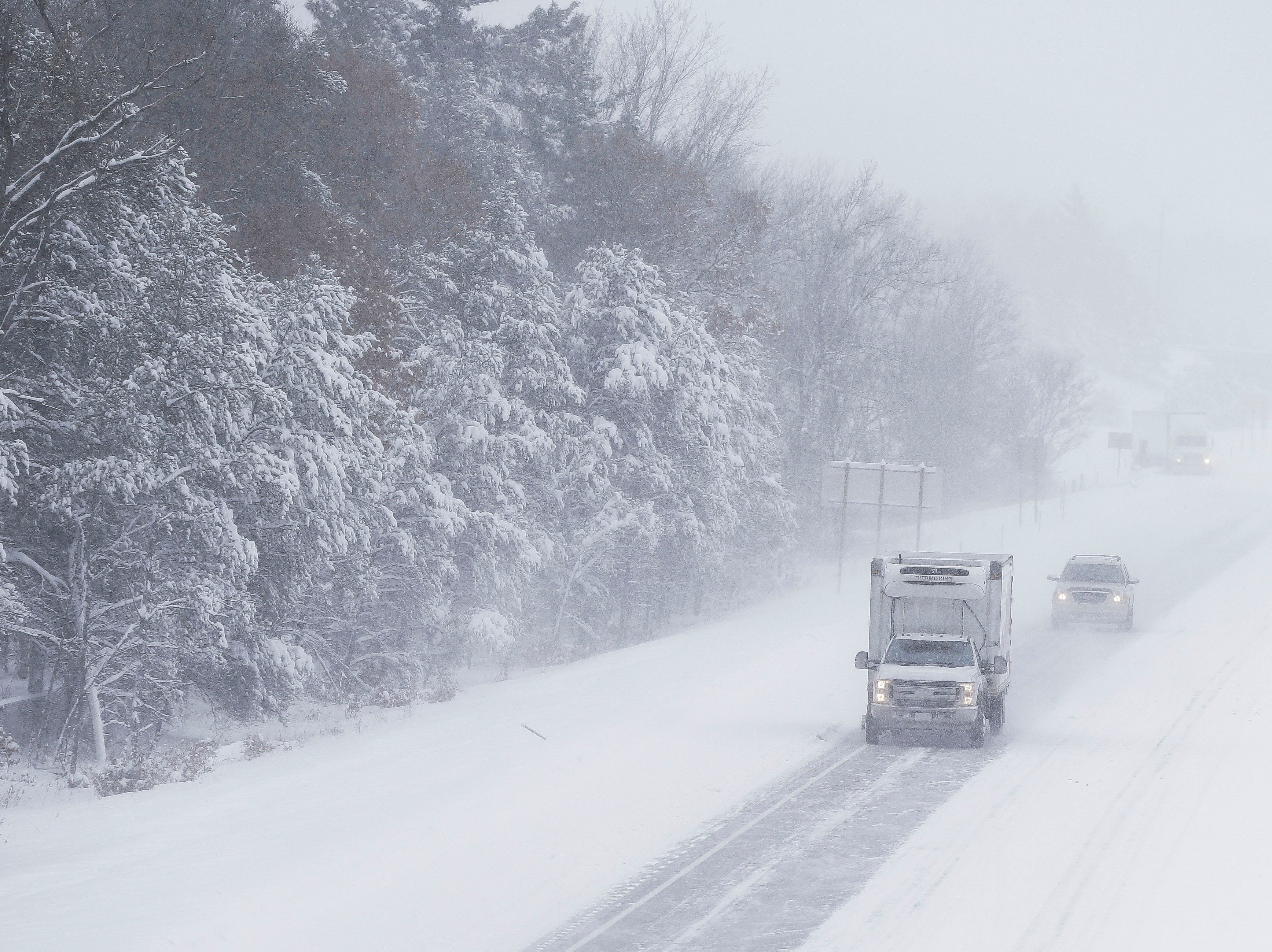 Traffic flows northbound on Interstate 39 on Tuesday, February 12, 2019, in Stevens Point, Wis. A winter storm is expected to drop 8-11 inches of snow in central Wisconsin before clearing Tuesday night.