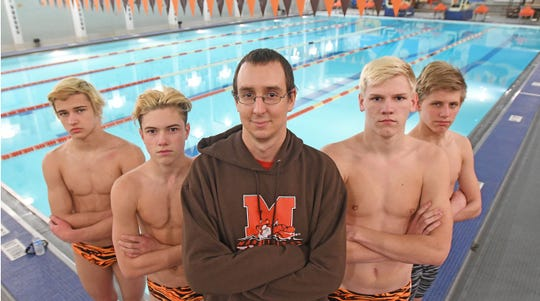 Mansfield Senior Swimming head coach Jacob Perl is flanked by district meet qualifiers Chase Blackstone Noah Anderson, Jarrod Queen and Reese Vaught.