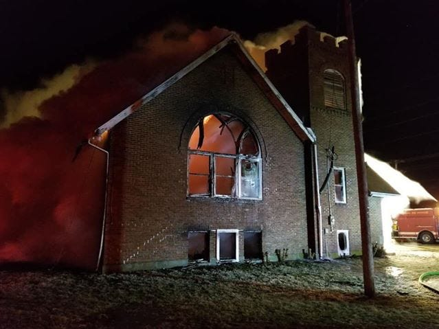 A fire destroyed a former church on Likens Road Friday evening.