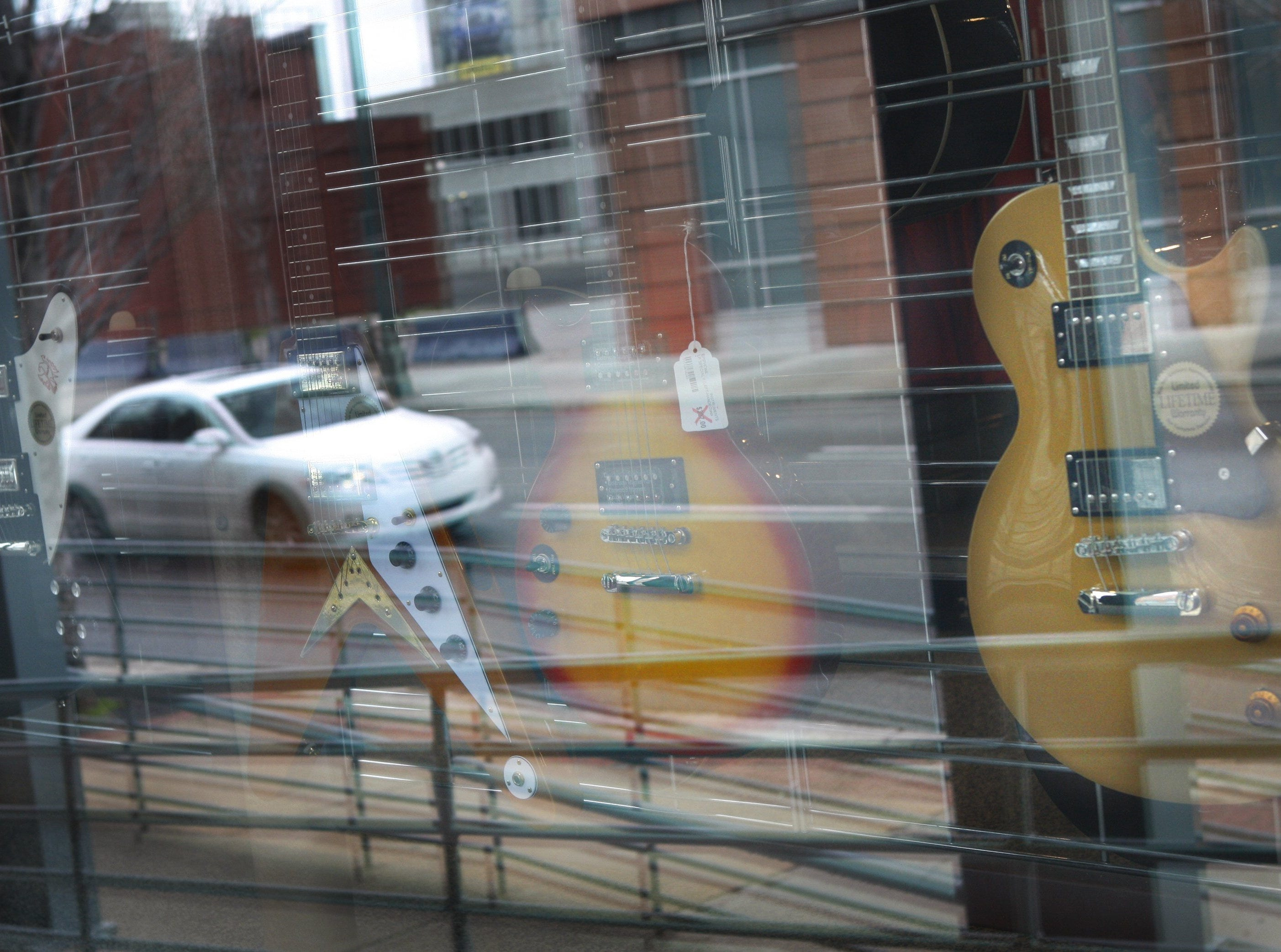 Jan. 25, 2012 - Guitars are displayed in the window of the Gibson Guitar Factory.