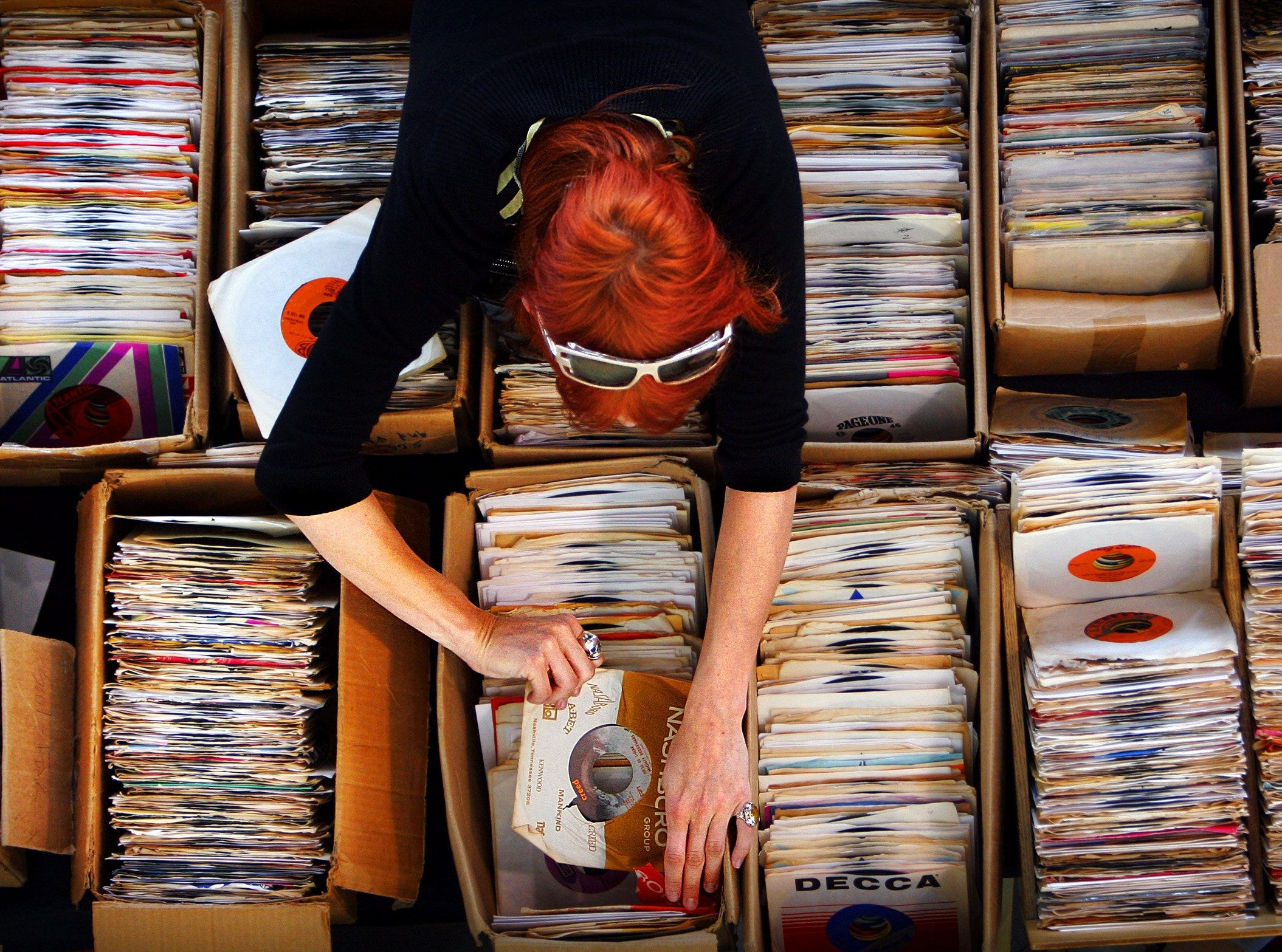 May 8, 2006  - Record collector Miss Alyssa, a music DJ from New York, peruses old 45's searching for soul records during a record swap to kick off the Ponderosa Stomp at the Gibson Guitar Factory.