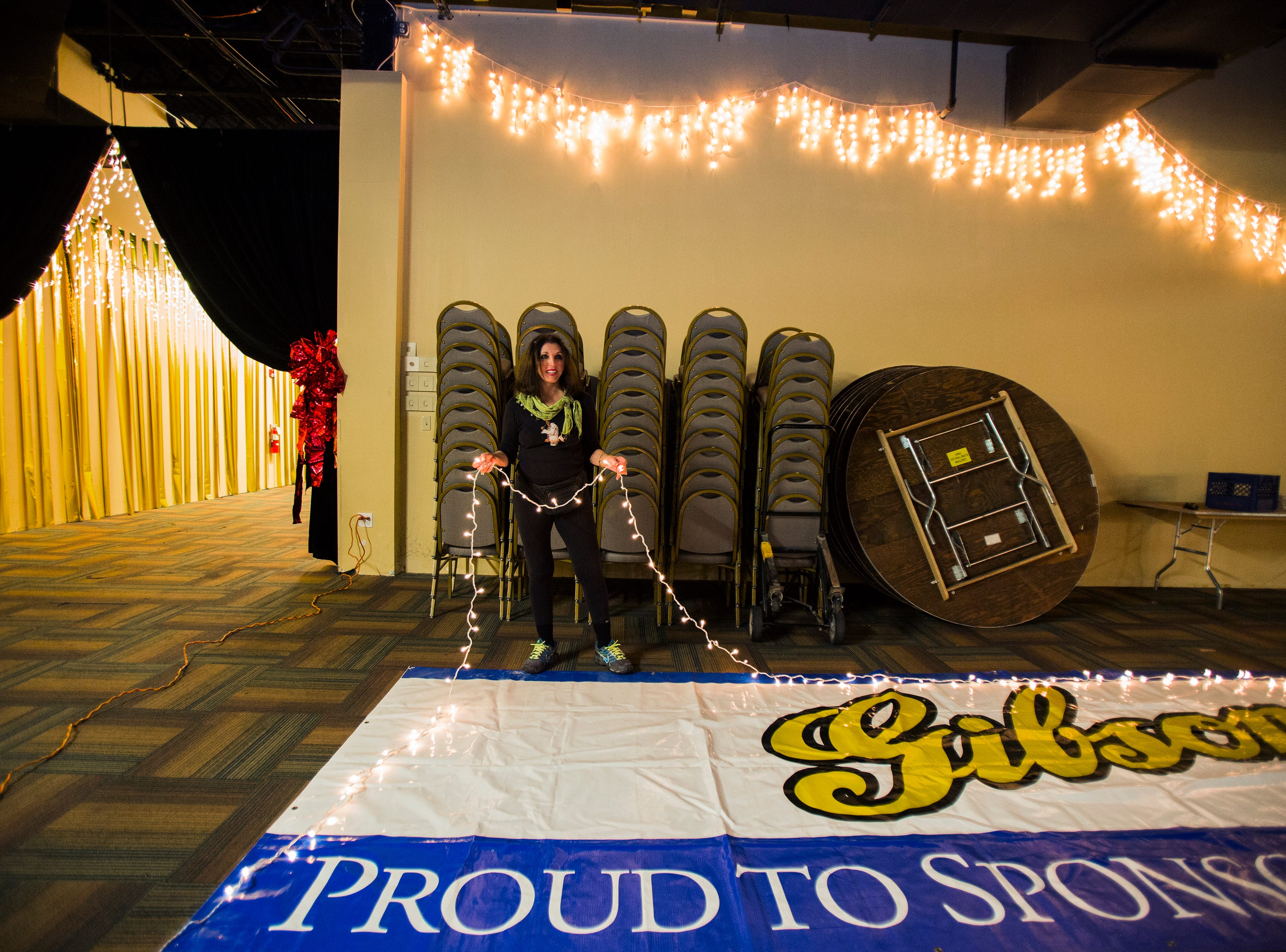 Sept. 23, 2014 - Pat Kerr Tigrett, founder and general chairman of the Blues Ball, outlines a banner with white Christmas lights as she decorates a room at the Gibson Guitar Factory.