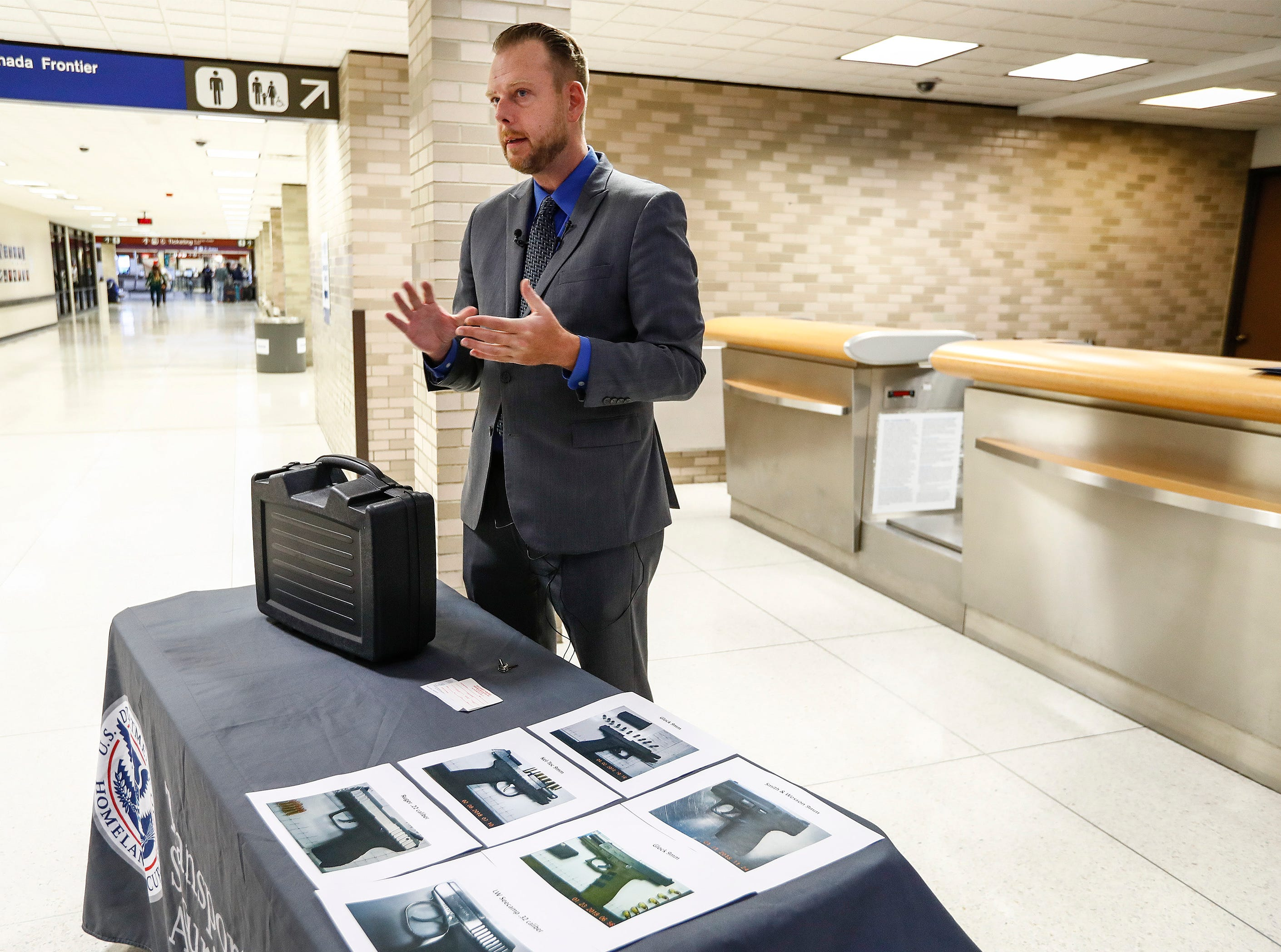 Mark Howell, TSA Regional Spokesperson, demonstrates the proper way for travelers to care their guns with them when they flying at the Memphis International Airport.