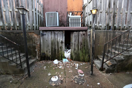Trash is left stuffed underneath patios at the Fox Hollow Town Homes where owners and management spent the afternoon in Shelby County's environmental court addressing the blight and trash removal issues at the Fox Meadows community on Tuesday, Feb. 12, 2019.