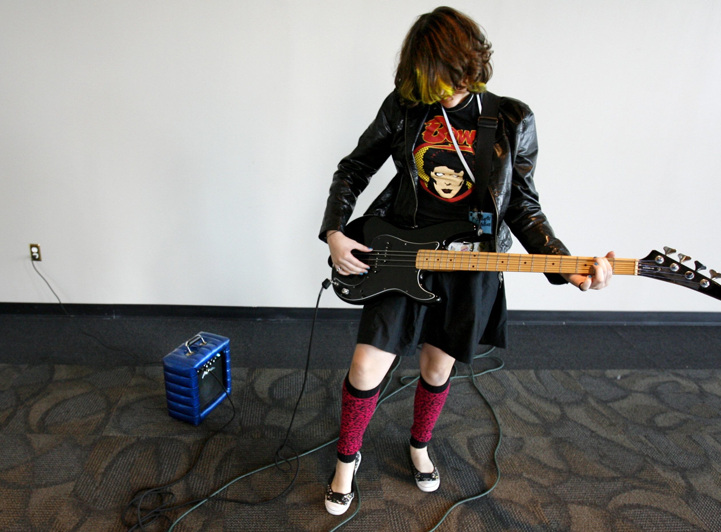 June 18, 2007 - Midtown resident Bridgette Wallace, 14, messes around on a bass guitar on the first day of the Southern Girls Rock & Roll Camp being held at the Gibson Guitar Factory.