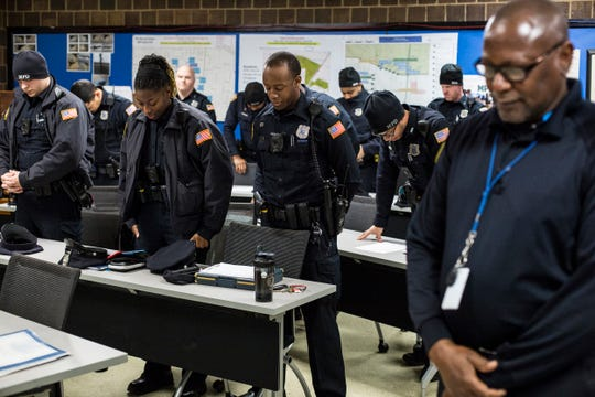 Memphis police officers bow their heads in prayer before the start of their shift during roll call at the Memphis Police Department's Mt. Moriah Station.