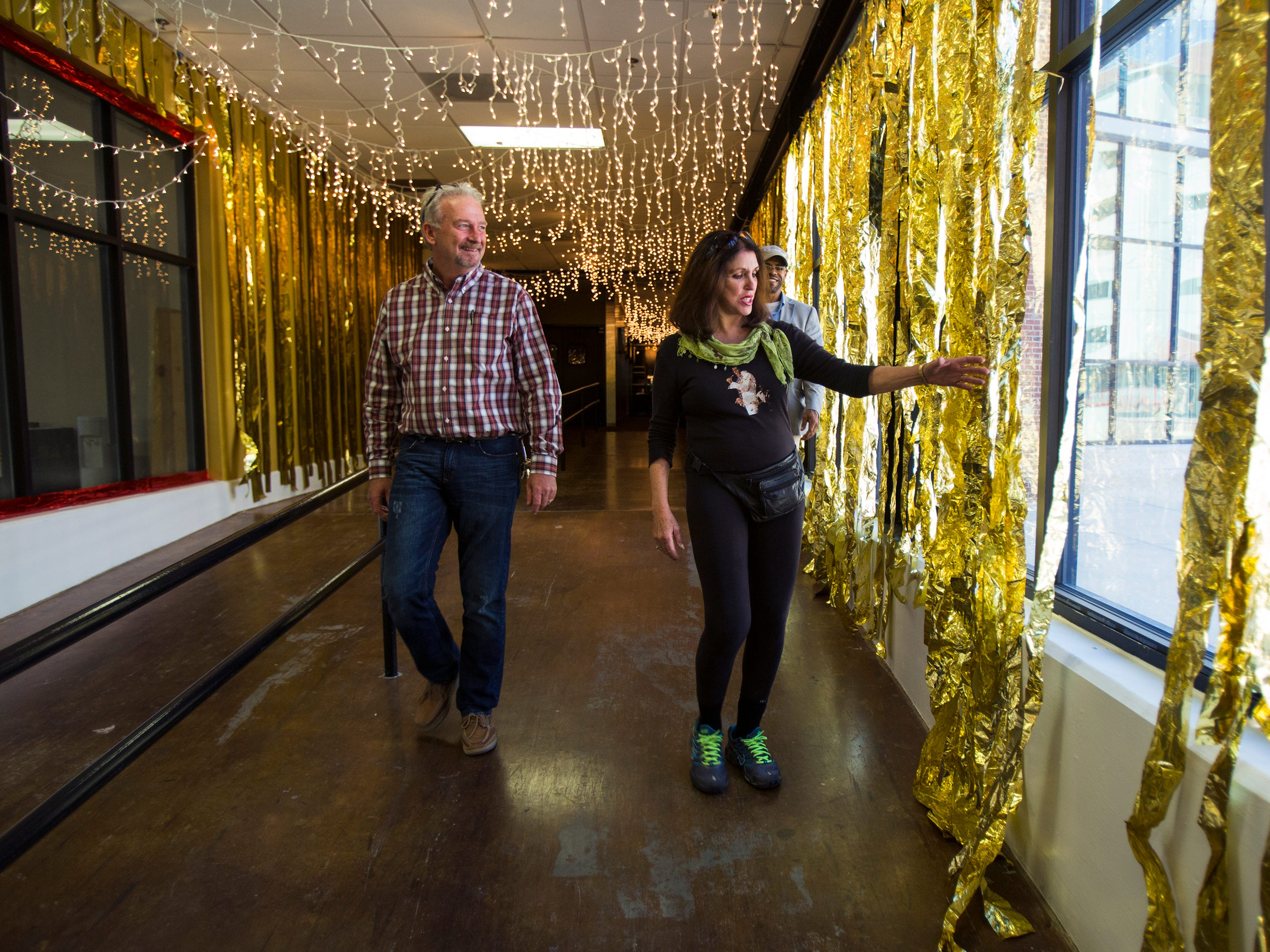 Sept. 23, 2014 - Dave Winters, general manager, Gibson Custom Shop, receives a quick tour by Pat Kerr Tigrett, founder and general chairman of the Blues Ball, as she shows him decorations she and her team have installed at the Gibson Guitar Factory.