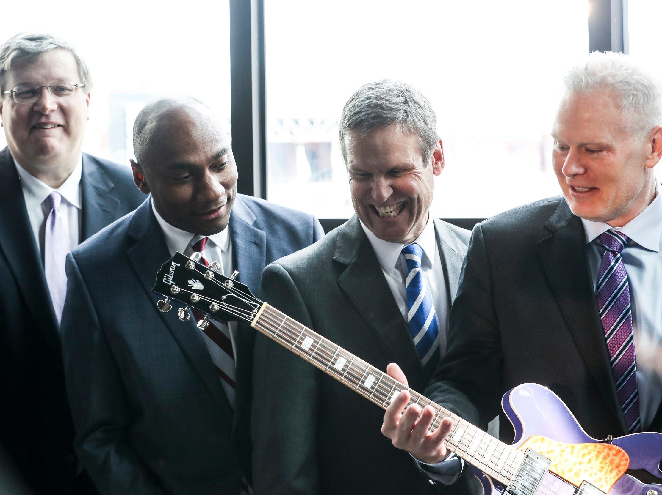 Memphis Mayor Jim Strickland, left, Shelby County Mayor Lee Harris, Gov. Bill Lee and FedEx Logistics CEO Richard Smith pose for photos during the announcement Feb. 12, 2019, that FedEx Logistics is relocating to the Gibson Guitar building.