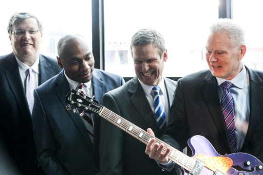 Memphis Mayor Jim Strickland, left, Shelby County Mayor Lee Harris, Gov. Bill Lee and FedEx Logistics CEO Richard Smith pose for photos during the Feb. 12 announcement that FedEx Logistics would relocate to the Gibson Guitar building. FedEx will receive millions of dollars in state incentives for the relocation.