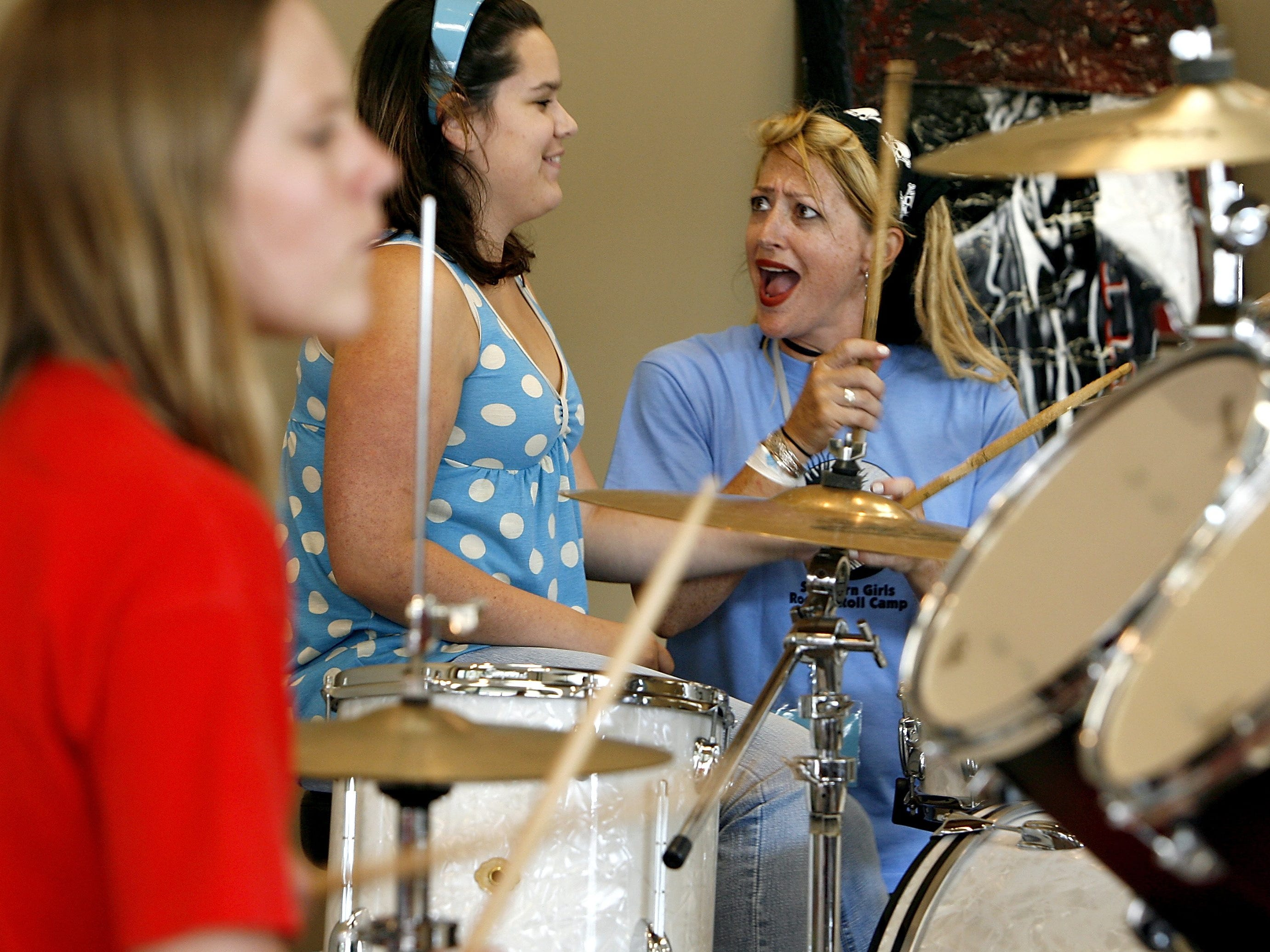 "June 18, 2007 - Memphis musician and volunteer instructor Amanda ""Flow"" Wood, right, gives Brittany Smith, 17, of Winston Salem, NC a crash course on playing drums during the first day of the Southern Girls Rock & Roll Camp being held at the Gibson Guitar Factory."