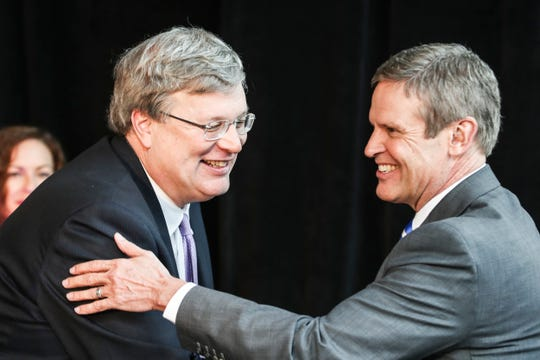Memphis Mayor Jim Strickland, left, and Gov. Bill Lee are seen during the announcement that FedEx Logistics is relocating to the Gibson Guitar Building. It was Lee's first economic development announcement since taking office.