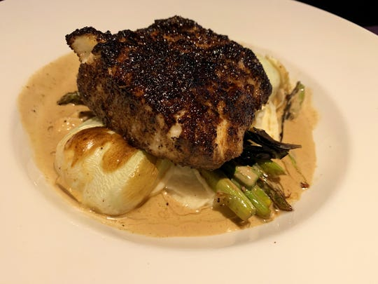 The porcini-crusted halibut from Yard House, Naples.