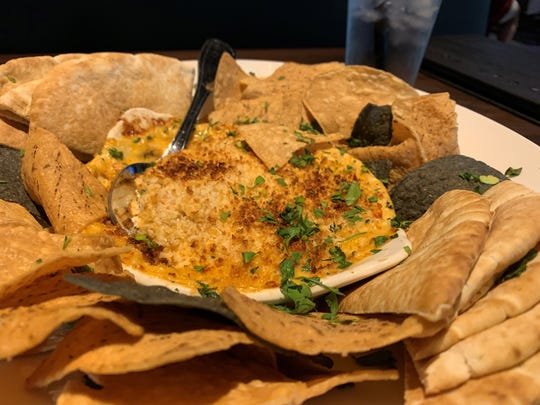 The lobster, crab and artichoke dip with pita and corn chips from Yard House, Naples.