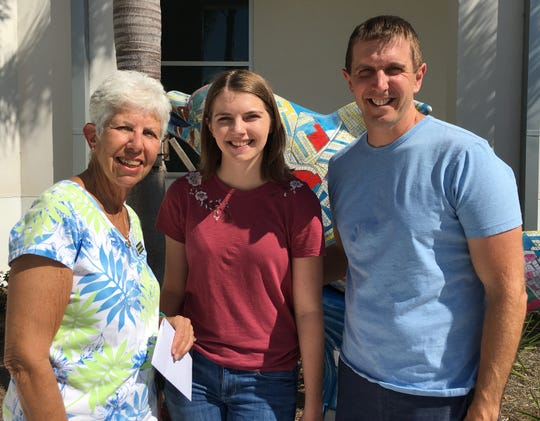 Marianne Foley, Calusa Garden Club scholarship chair, Madeline Grucci, 2018 college scholarship recipient, and Madeline's father Kyle Grucci.