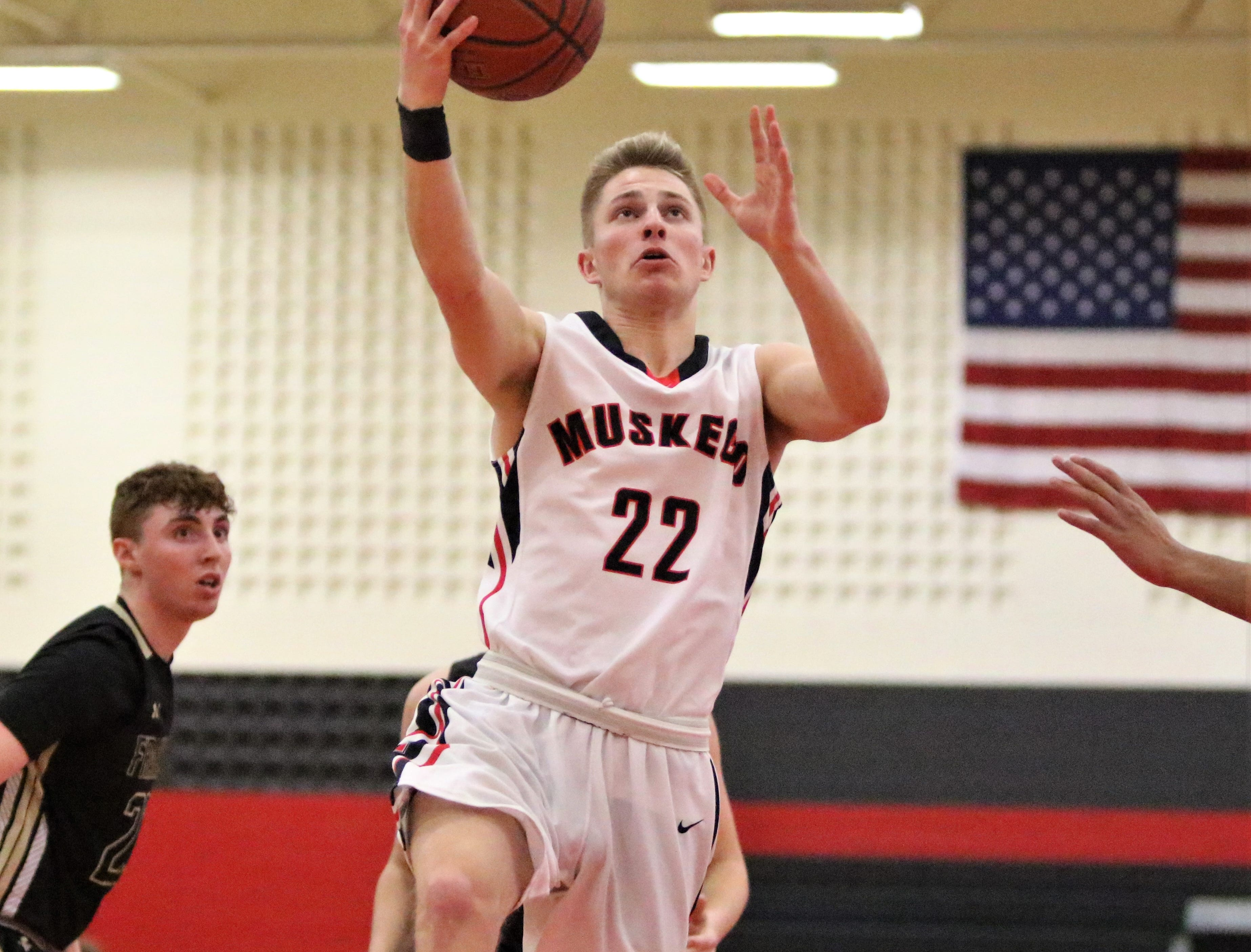 Muskego forward Sam Chovanec goes up for a layup against Franklin on Feb. 11, 2019.