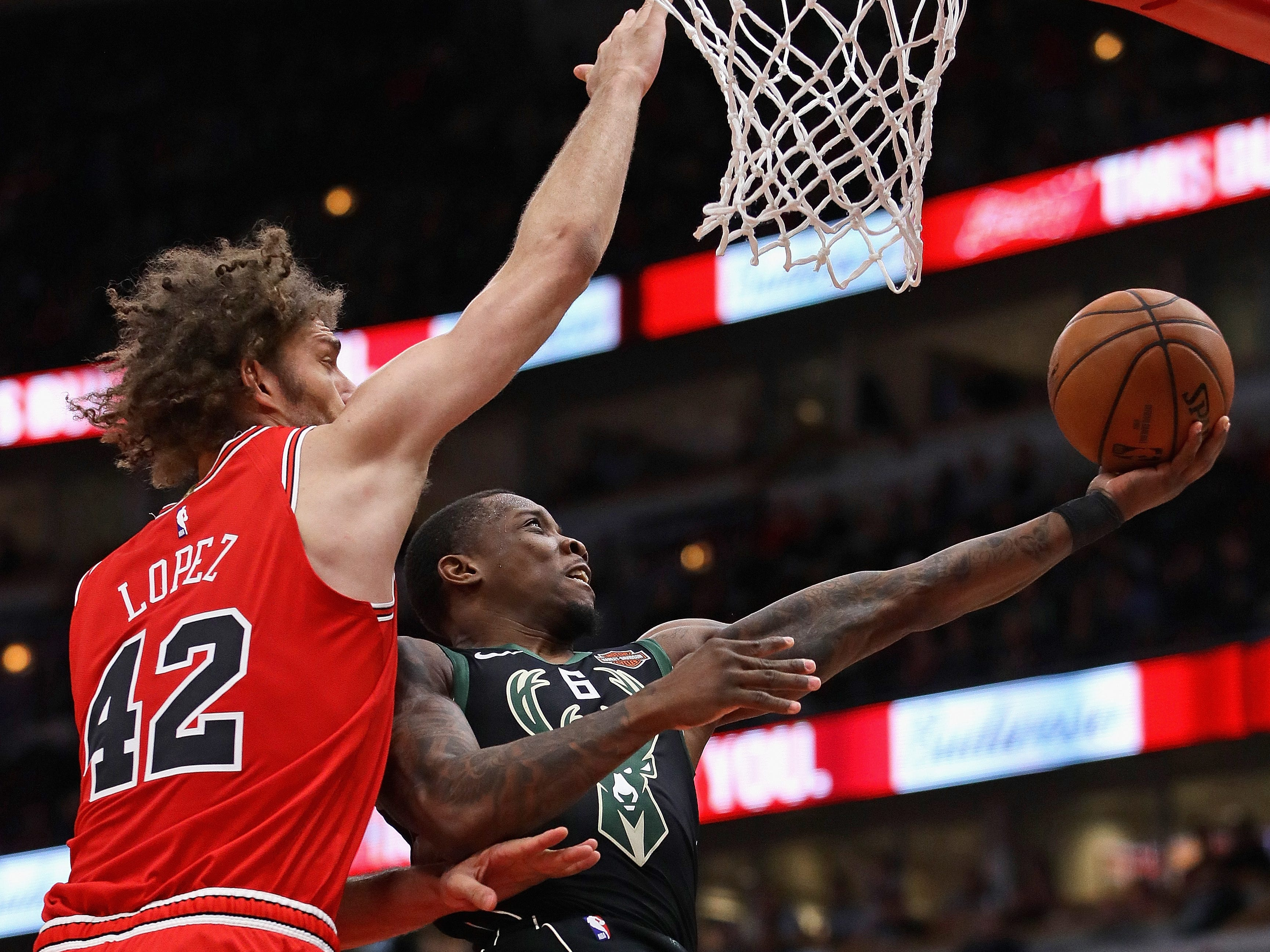 Bucks guard Eric Bledsoe gets past Robin Lopez of the Bulls for a reverse layup during the second half Monday.