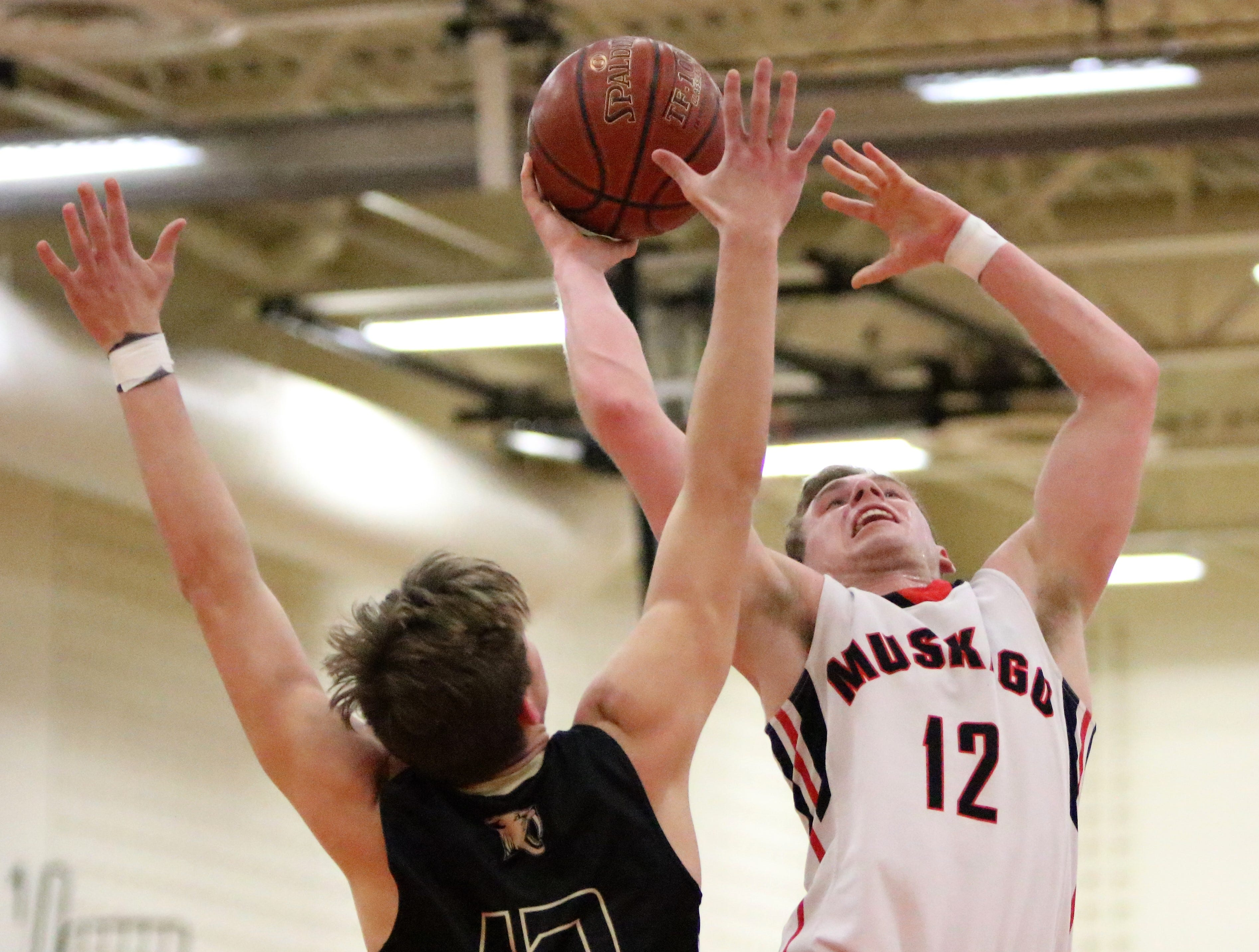 Muskego guard Austin Malkowski goes up for a layup against Franklin's Marko Rajkovic on Feb. 11, 2019.