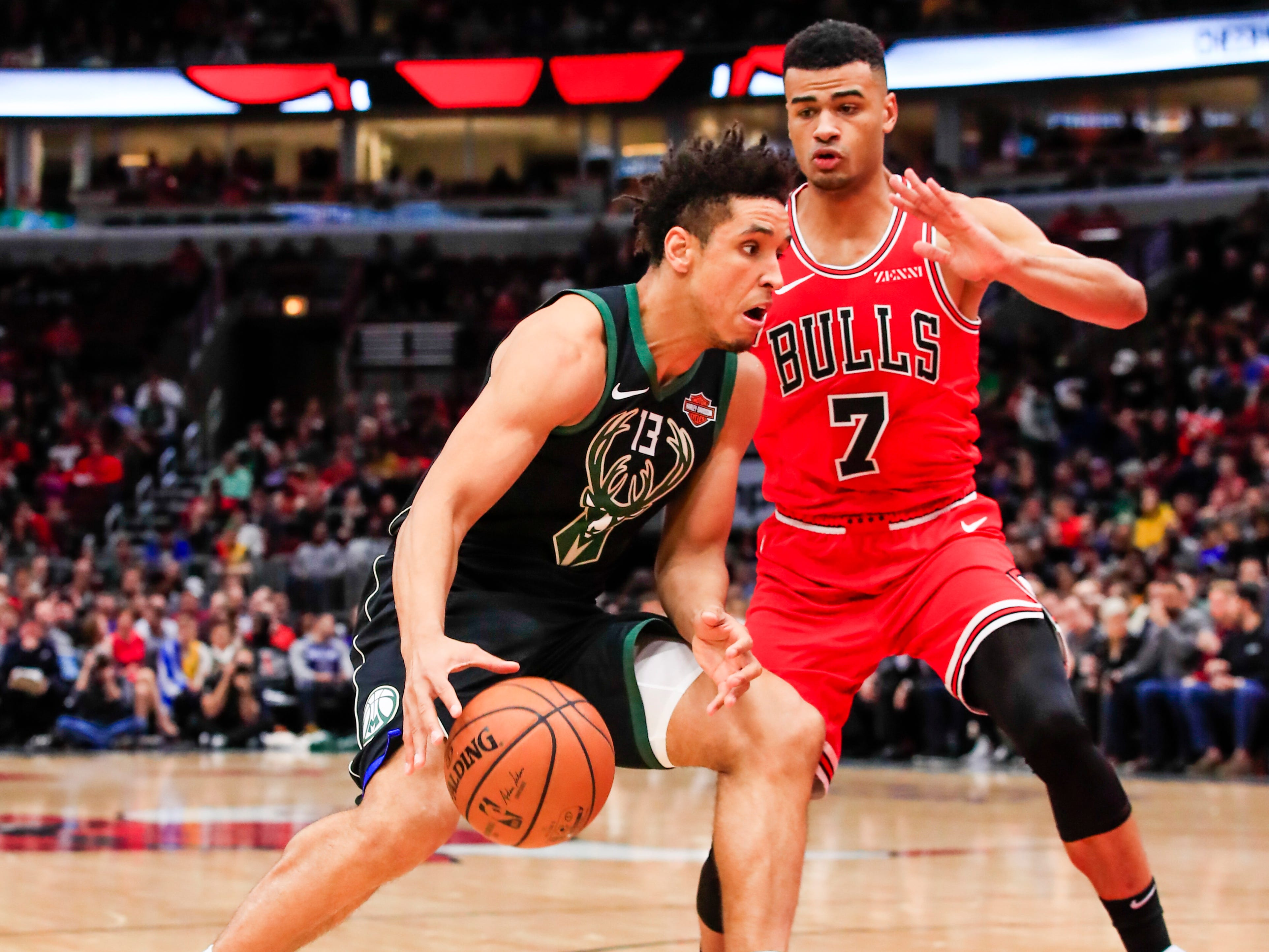 Bucks guard Malcolm Brogdon drives on Bulls guard Timothe Luwawu-Cabarrot on Monday night.