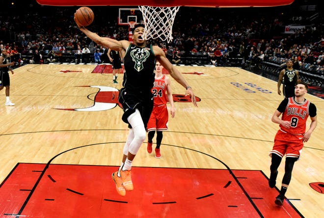 Giannis Antetokounmpo of the Bucks winds up for a dunk to finish off a bast break against the Bulls during the second half Monday.