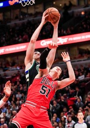 Bucks forward Ersan Ilyasova grabs a rebound over  Bulls guard Ryan Arcidiacono on Monday night.