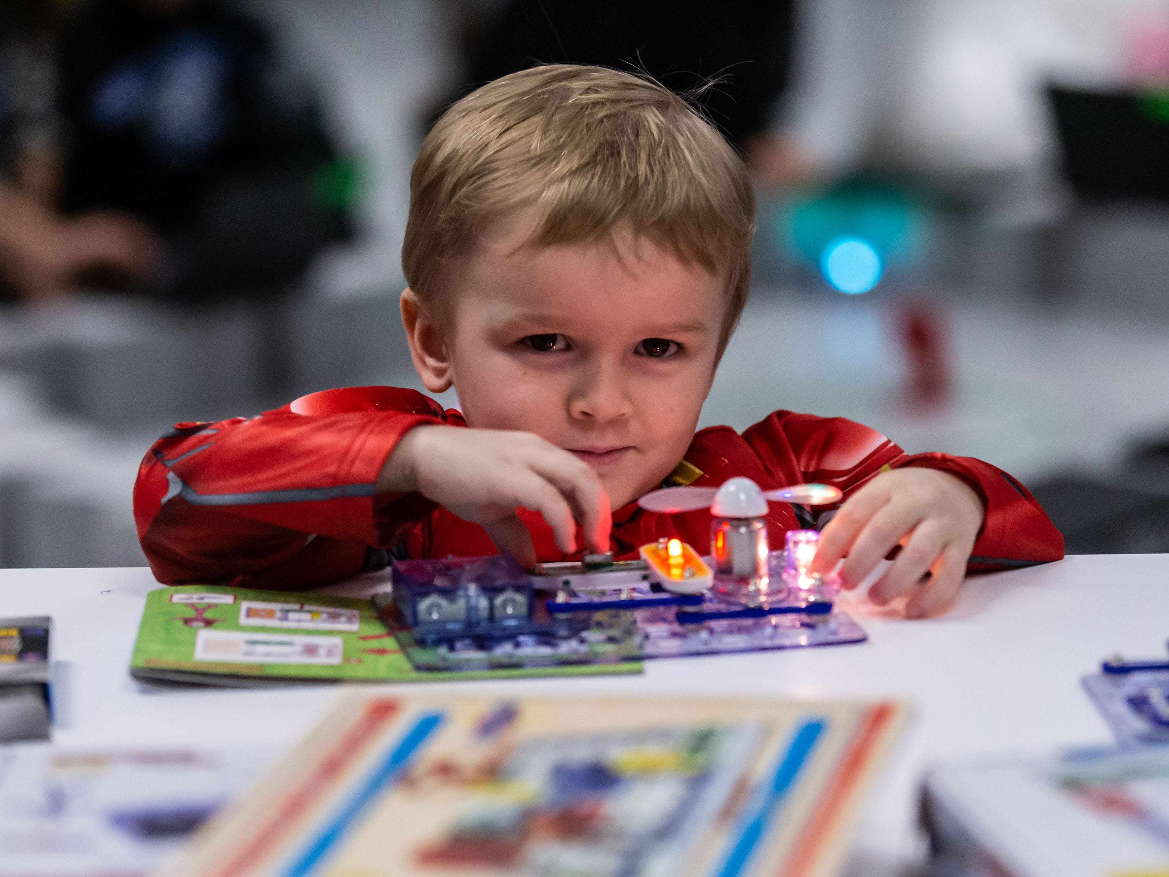 Two-year-old Donovan Holahan of Pewaukee tinkers with an electronics project during the open house event for the new Innovation Lab technology/engineering space at Lake Country School in Hartland on Monday, Feb. 11, 2019.