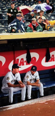 "Brewers acting manager Bob Melvin, left, and coach Doug Mansolino discuss the possibility of a double header against the Los Angeles Dodgers Monday night while waiting for the rain to stop at County Stadium in 1999. Melvin was named ""temporary interim manager"" in 1999 when Jim Lefebvre needed wrist surgery. Lefebvre was interim manager when the club fired Phil Garner as manager."