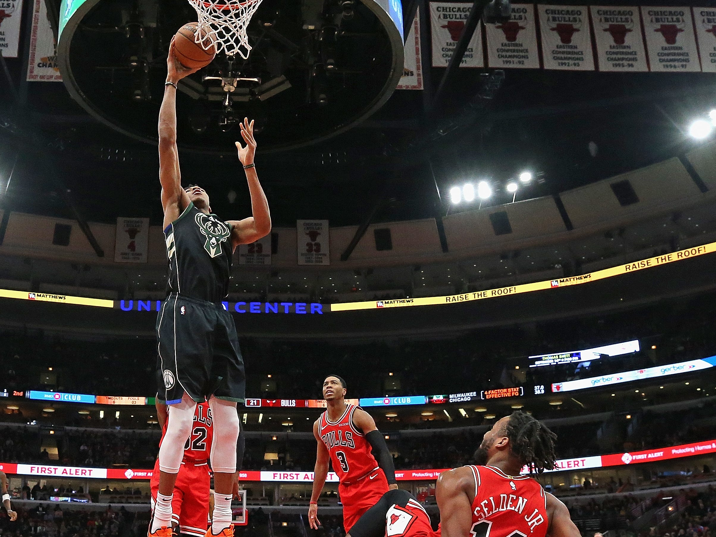Giannis Antetokounmpo goes up for a dunk after Wayne Selden of the Bulls tried to draw an offensive foul by flopping to the court as the Bucks forward drove to the basket during the second half Monday.