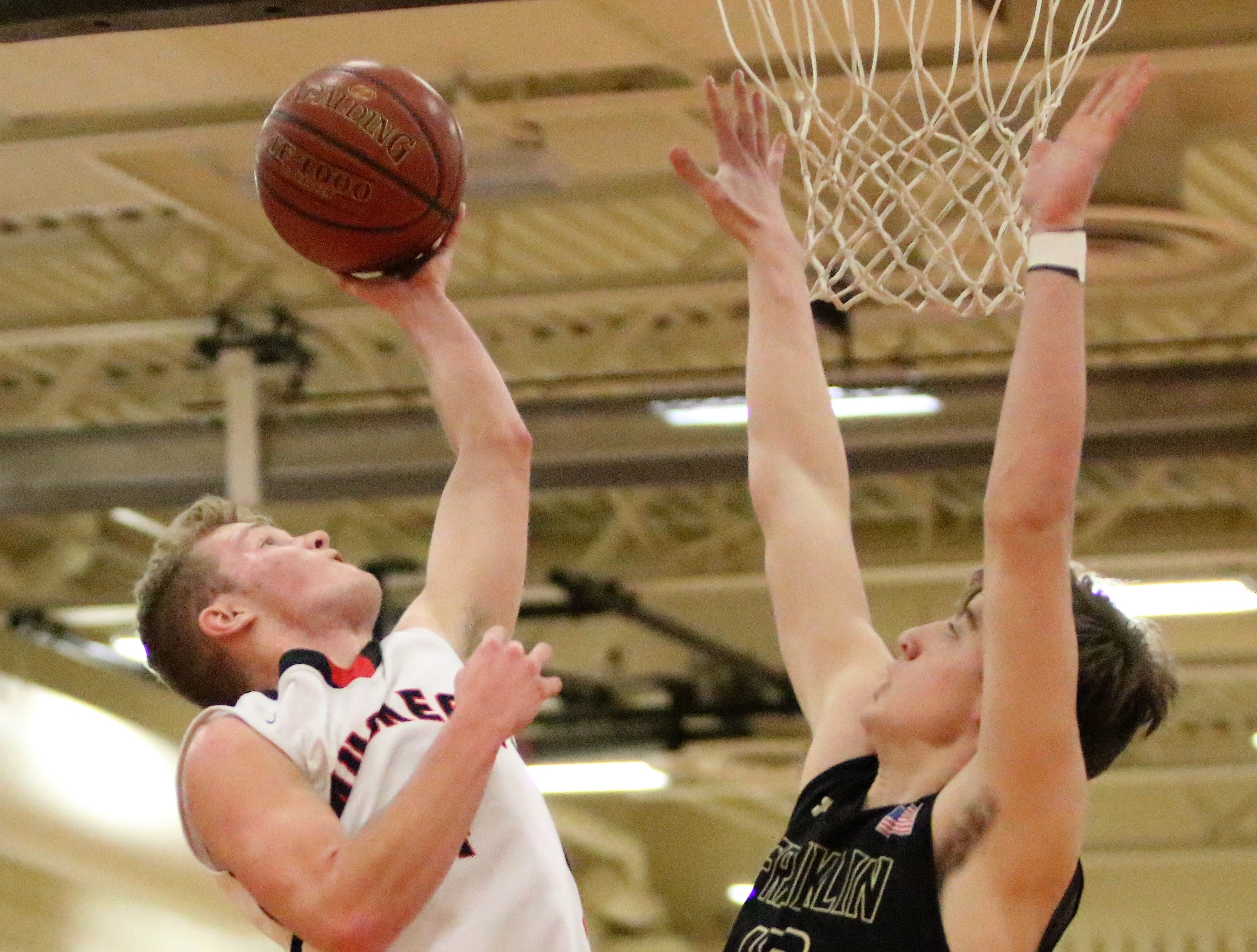 Muskego guard AJ Makinen sets the school record for scoring with a layup against Franklin on Feb. 11, 2019.