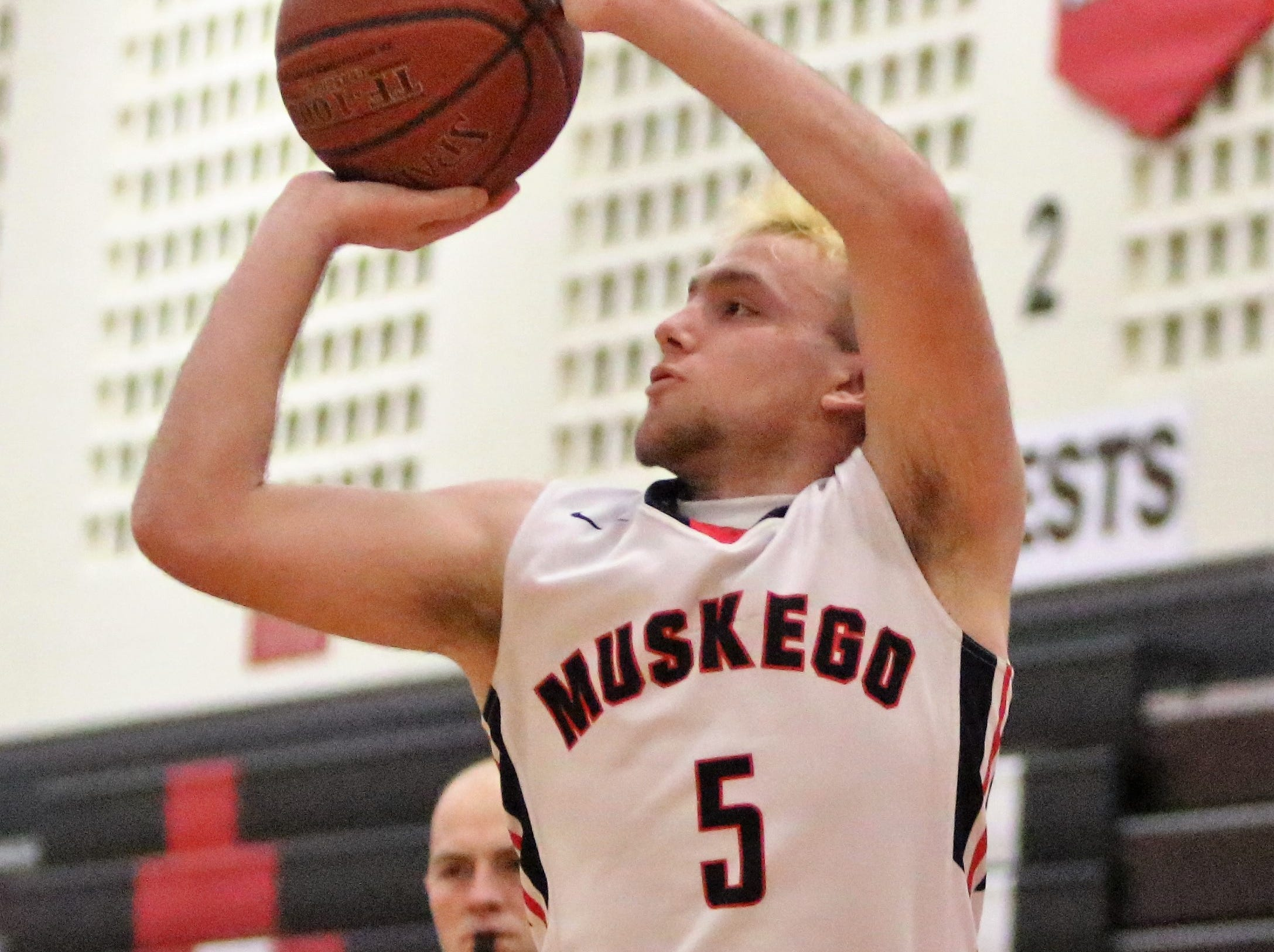 Muskego guard Wes Kwapick shoots a three-pointer against Muskego on Feb. 11, 2019.