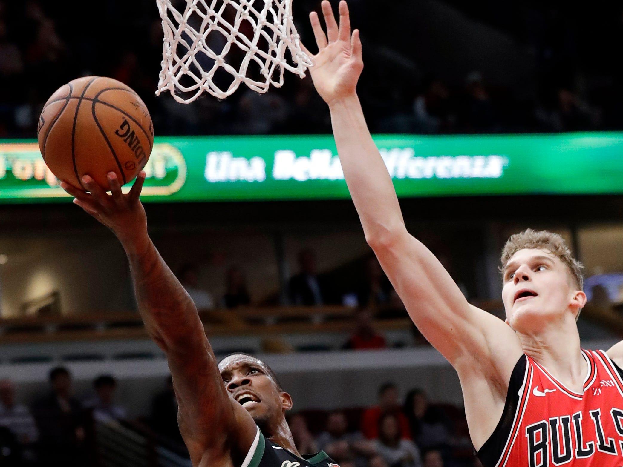 Bucks guard Eric Bledsoe gets to the rim for a layup ahead of Bulls forward Lauri Markkanen during the second half Monday.