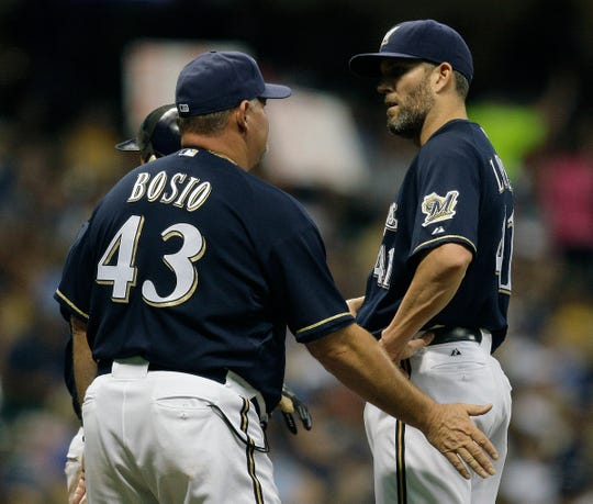 Milwaukee Brewers pitcher Braden Looper gets a visit from pitching coach Chris Bosio against the Philadelphia Phillies at  Miller Park on Sept. 26, 2009.