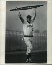 Frank Howard, imposing at 6-7, moves equipment around during spring training in 1979.