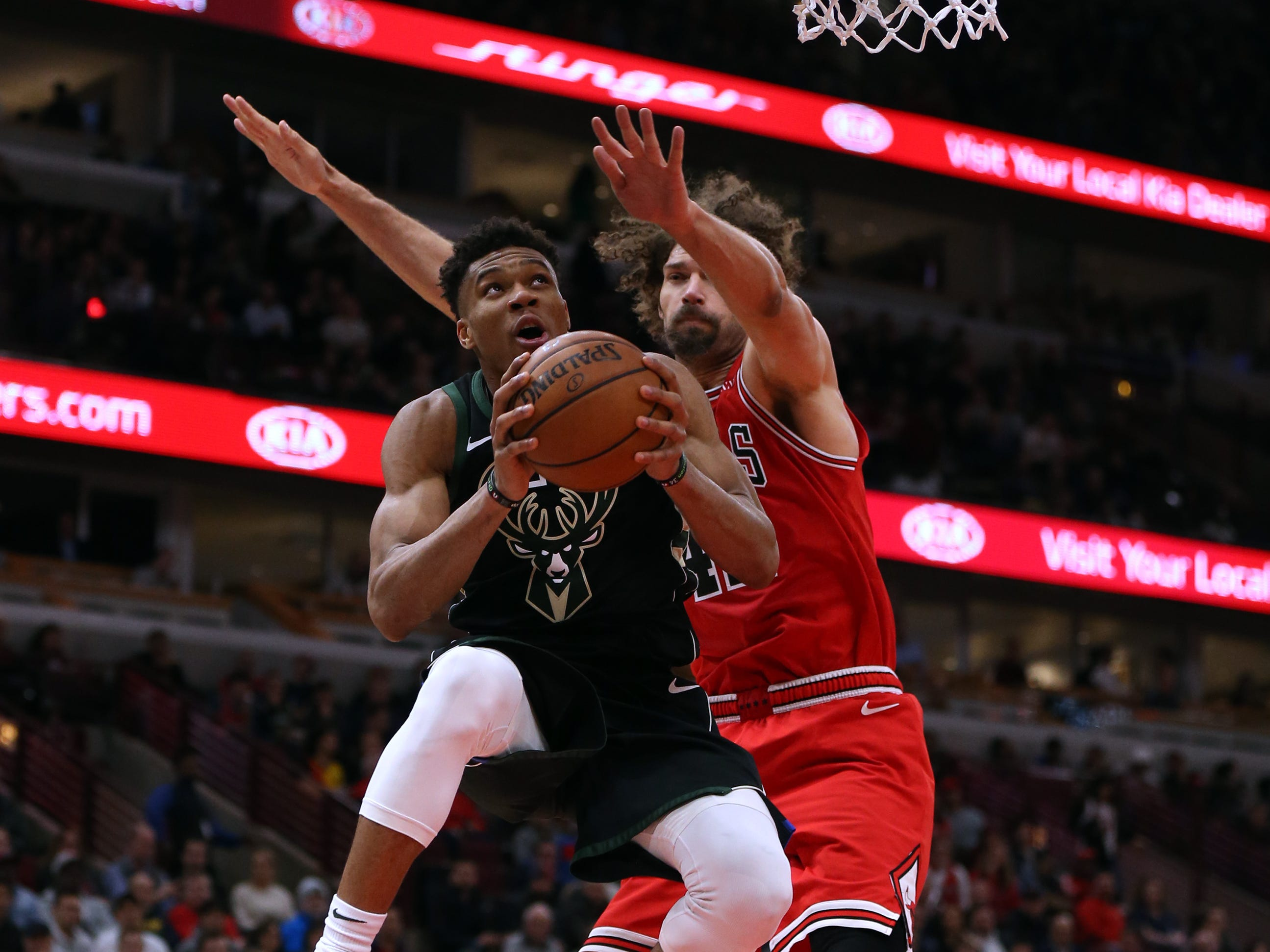 Bucks forward Giannis Antetokounmpo drives to the basket as Bulls center Robin Lopez defends him during the first half Monday.