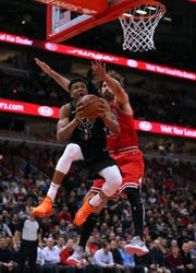 Milwaukee Bucks forward Giannis Antetokounmpo (34) drives to the basket as Chicago Bulls center Robin Lopez (42) defends during the first half of an NBA basketball game between the Bulls and the Bucks at the United Center in Chicago on Monday, Feb. 11, 2019. (Terrence Antonio James/Chicago Tribune/TNS)  ORG XMIT: 1267562