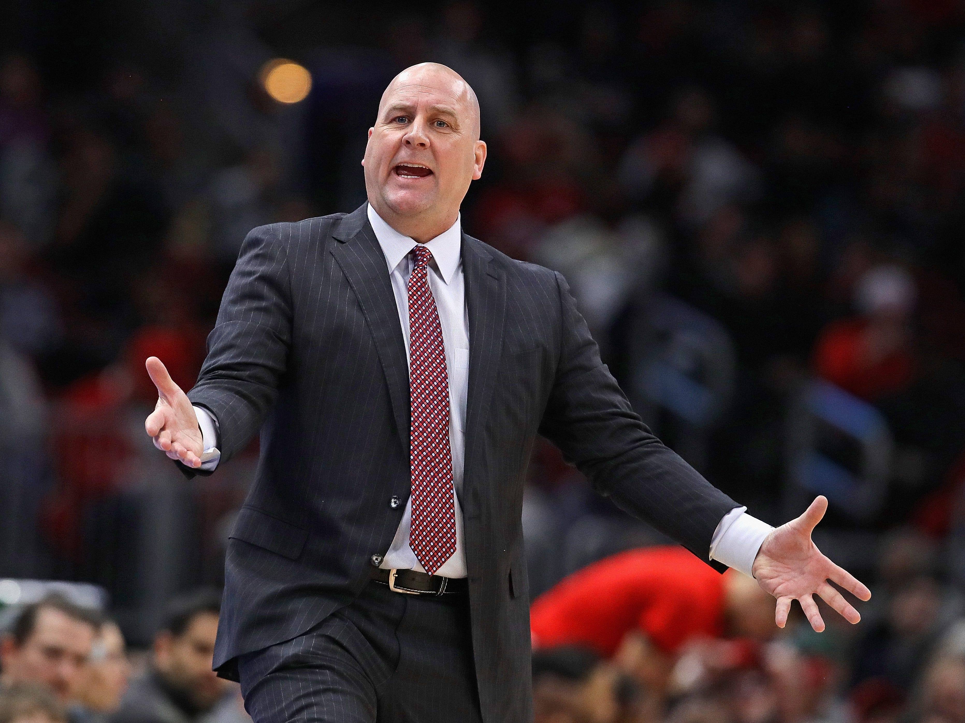 Bulls head coach Jim Boylen, who played on Marquette's NCAA title team, questions a call during Chicago's game against the Bucks on Monday night.
