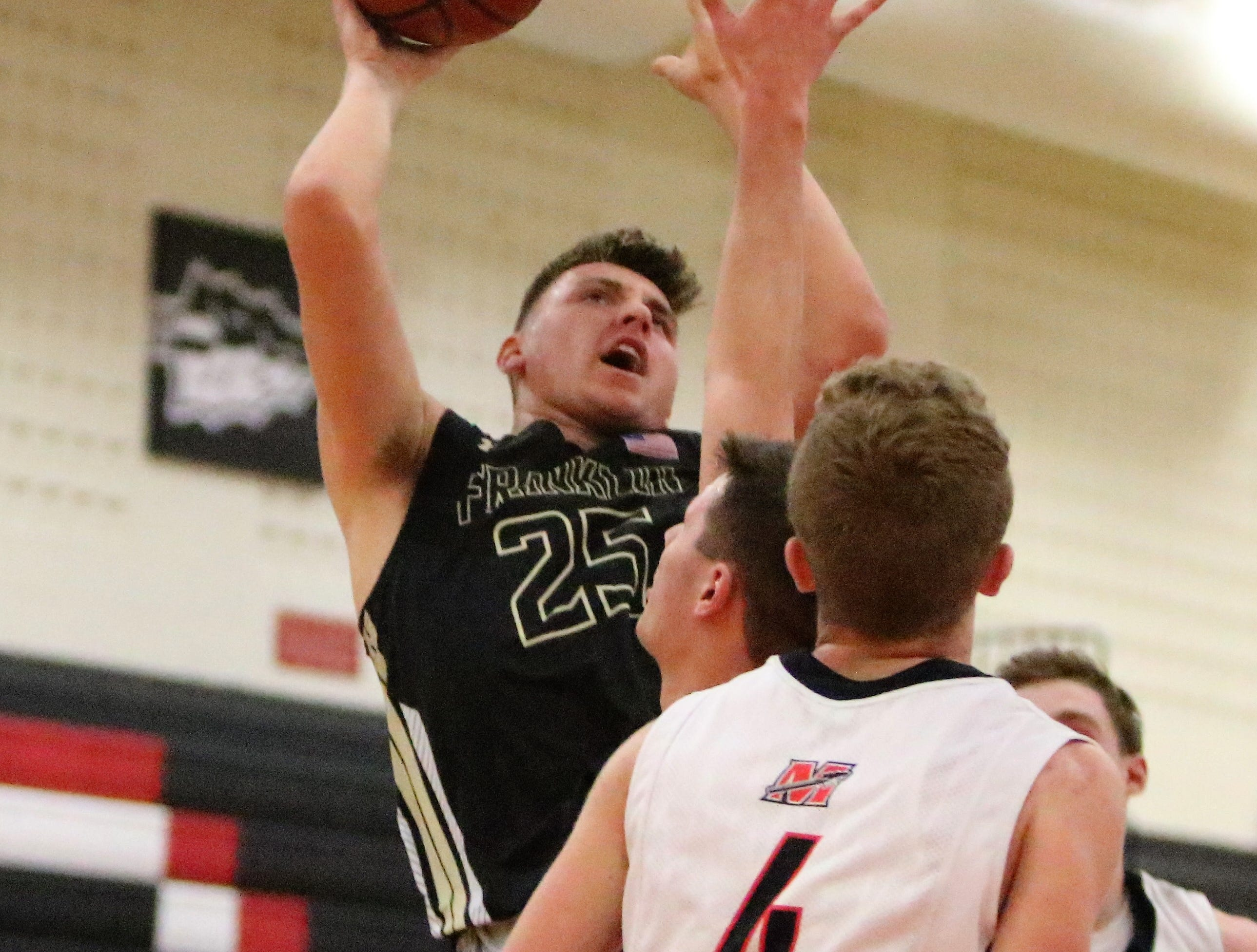 Franklin forward Carter Capstran puts up a shot in the post against Muskego on Feb. 11, 2019.