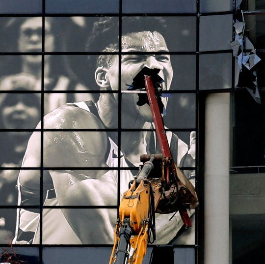 The glass atrium on the front of the Bradley Center with the face of Milwaukee Bucks star Giannis Antetokounmpo is shattered as demolition continues Tuesday.
