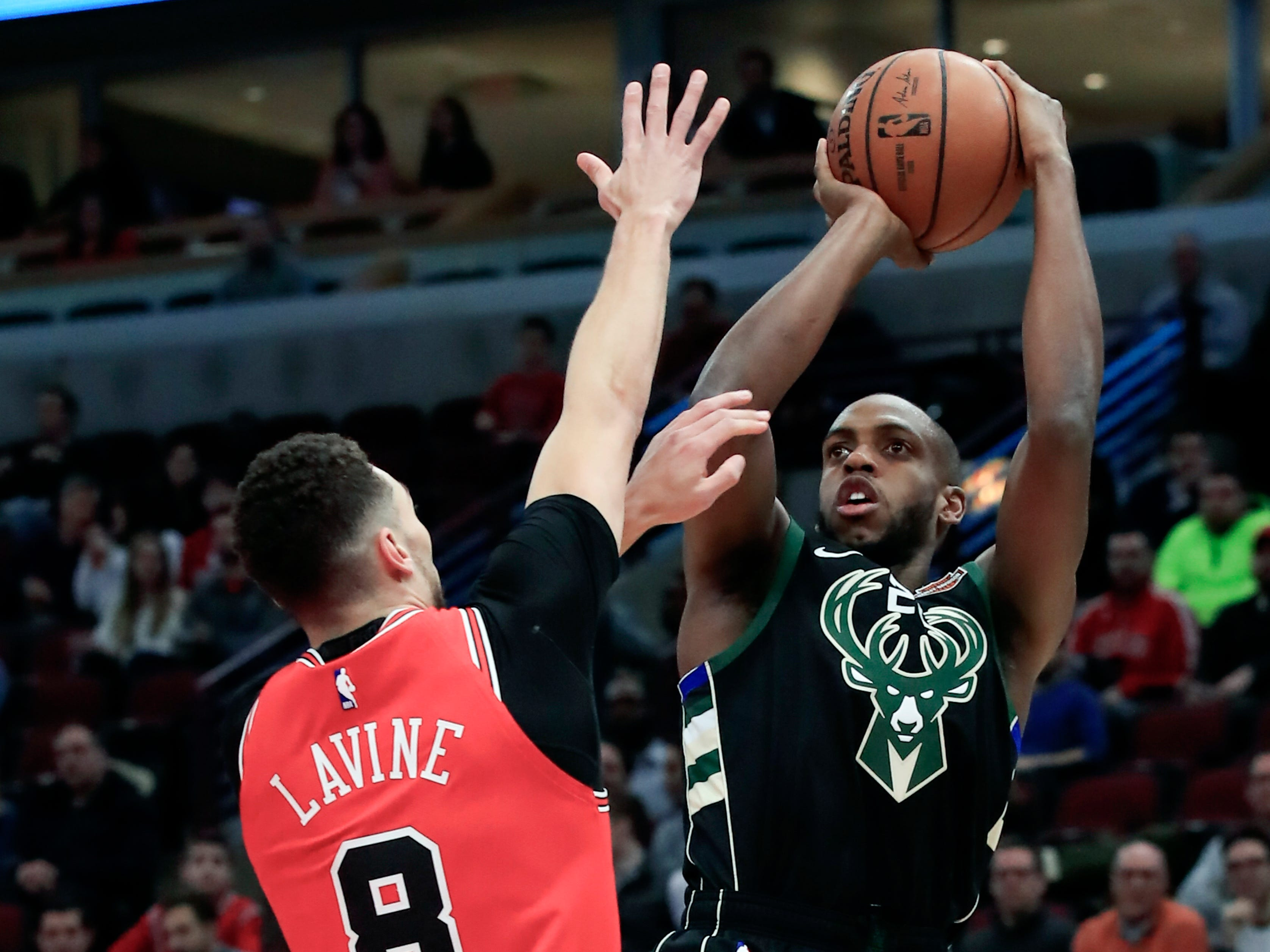 Bucks forward Khris Middleton gets ready to toss up a fadeaway jumper over Bulls guard Zach LaVine on Monday night.