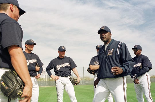 Milwaukee Brewers pitching coach Dave Stewart addresses some of the Brewers pitchers during their first day of spring training in 2001.